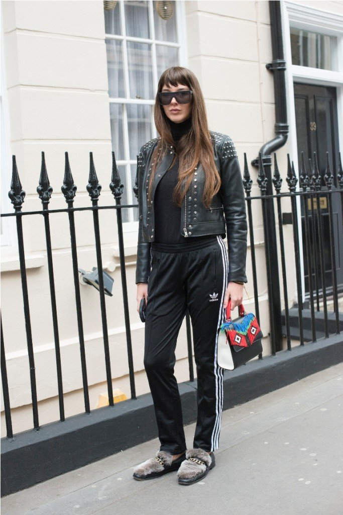 LONDON, ENGLAND - FEBRUARY 23: Fashion stylist Estelle Pigault wears Adidas tracksuit trousers, Bershka jacket, Boyy shoes, Les Petits Joueursbag and Quay sunglasses on day 5 during London Fashion Week Autumn/Winter 2016/17 on February 23, 2016 in London, England.  (Photo by Kirstin Sinclair/Getty Images)*** Local Caption *** Estelle Pigault
